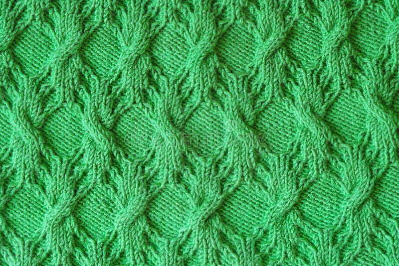 Абстрактная текстурированная предпосылка зеленый вязать стоковое изображение rf