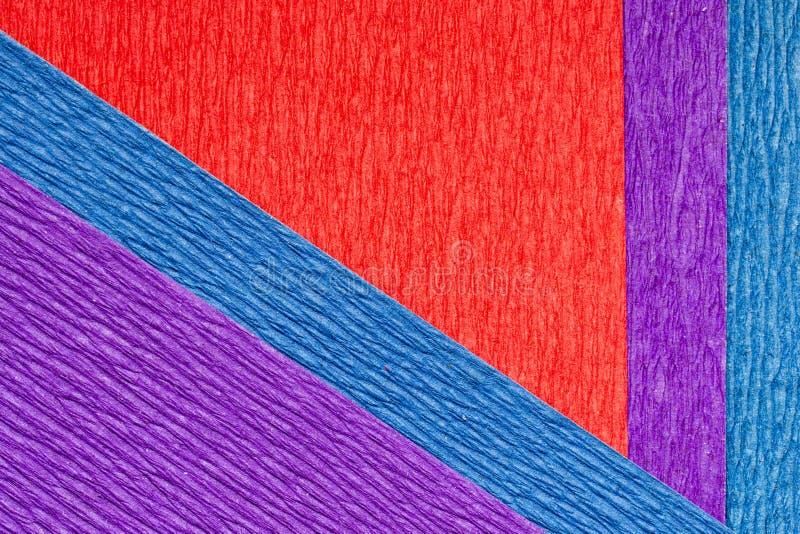 Абстрактная текстурированная предпосылка раскосные пурпурного, красный и синь крепируют бумагу стоковое изображение rf