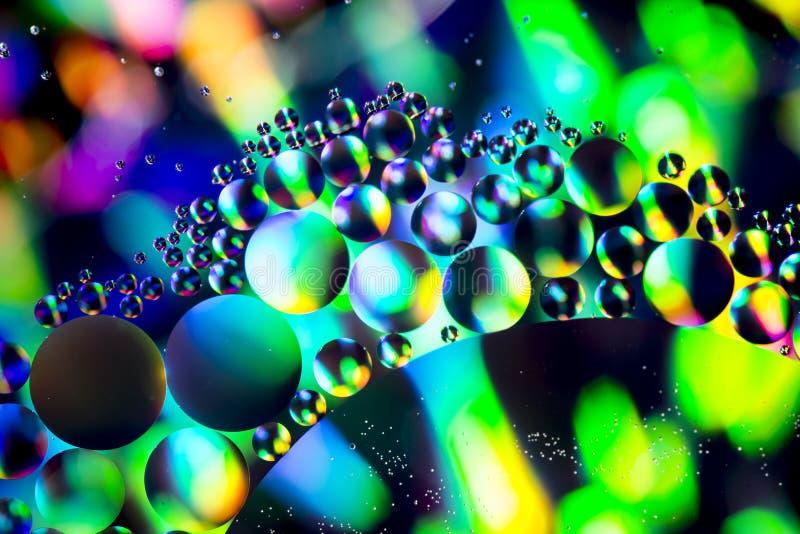 Абстрактное красочное масло предпосылки в конце воды вверх стоковые фото