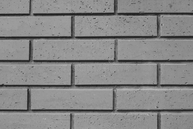 Абстрактное черно-белое изображение близкой поднимающей вверх кирпичной стены которое внешний дизайн дома глины стоковая фотография