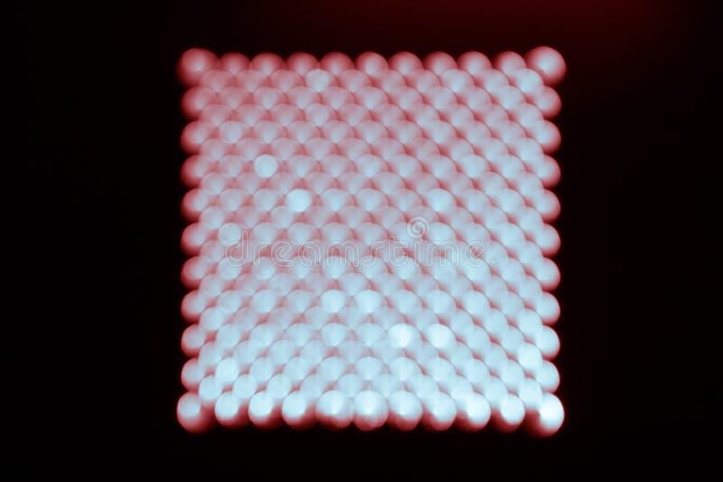 Абстрактное bokeh предпосылки, голубых и красных на черноте в форме квадрата стоковое изображение rf