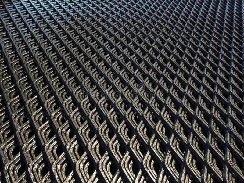 Абстрактные линии и промышленная картина сетки металла стоковое фото