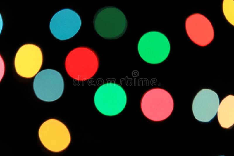 Абстрактные расплывчатые света bokeh рождества и освещения, пинка, желтых, красных и голубых Нового Года defocused, предпосылки стоковая фотография rf