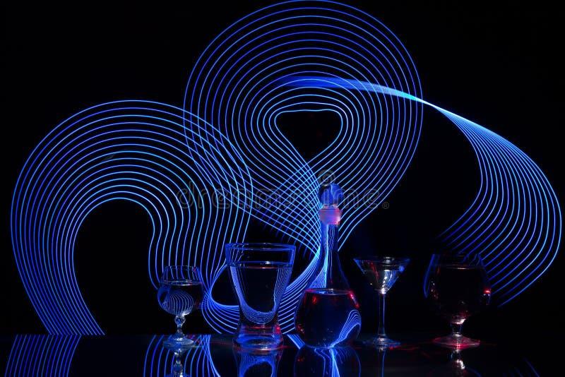 Абстрактные силуэты с luminography лазера стоковые фото