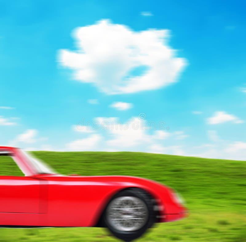 Абстрактный взгляд красного движения автомобиля спорт тяжелого запачканного стоковые изображения