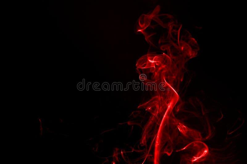 абстрактный дым красного цвета ладана стоковые фотографии rf