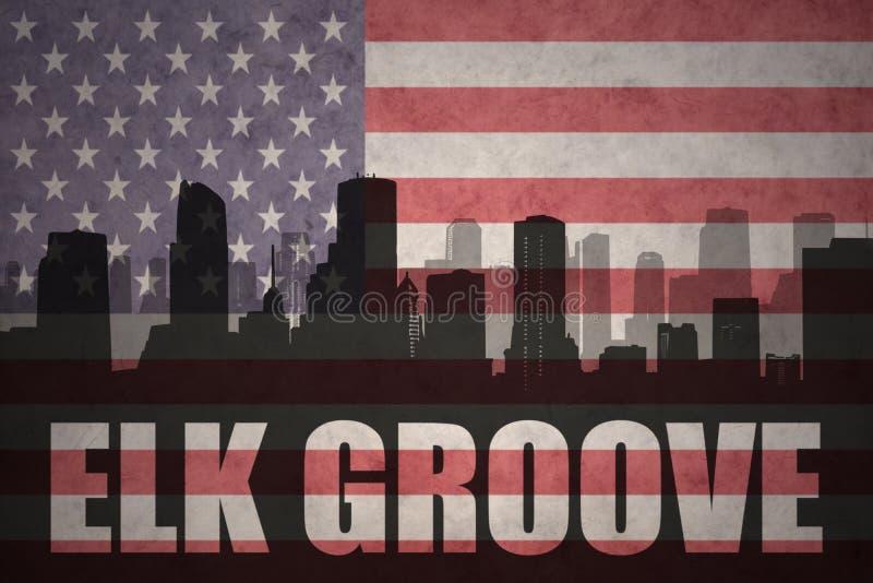 Абстрактный силуэт города с рощей лося текста на винтажном американском флаге стоковое фото