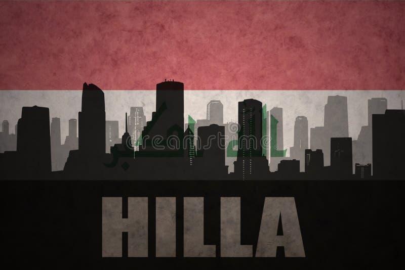Абстрактный силуэт города с текстом Hilla на винтажном иракском флаге стоковые фото