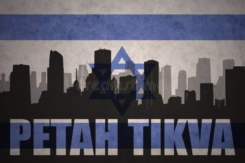 Абстрактный силуэт города с текстом Petah Tikva на винтажном флаге Израиля бесплатная иллюстрация