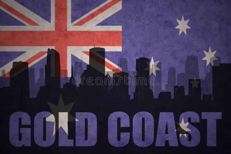 абстрактный силуэт города с текстом Gold Coast на винтажном австралийском флаге иллюстрация штока