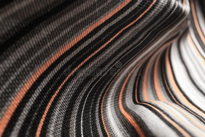 Абстрактный фон тканей с оранжевыми, черными и белыми цветами стоковые изображения rf