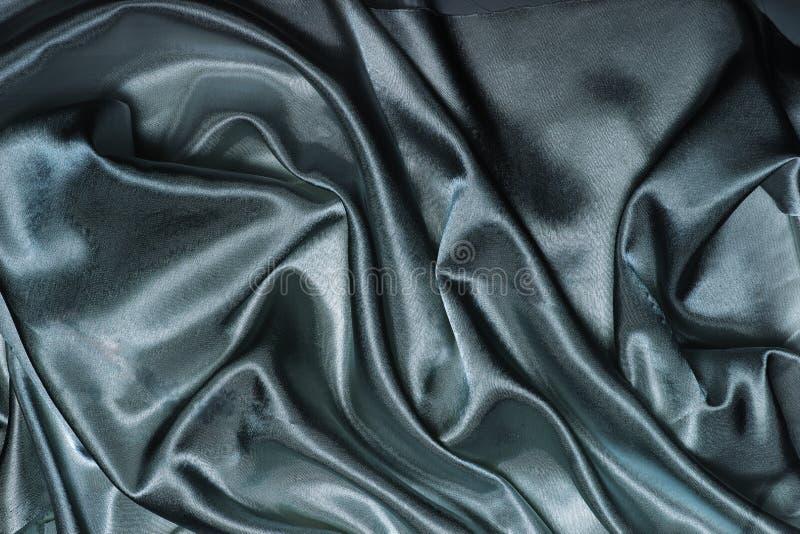 Абстрактный фон черно-голубой шелковой ткани стоковые фото