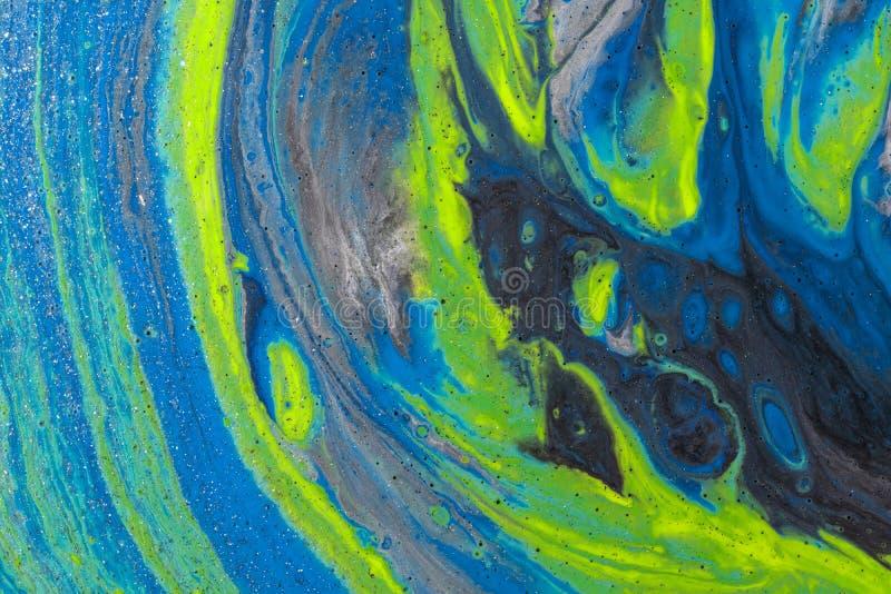 Абстрактный цвет фона из-за закрытия разлитых красок стоковые изображения