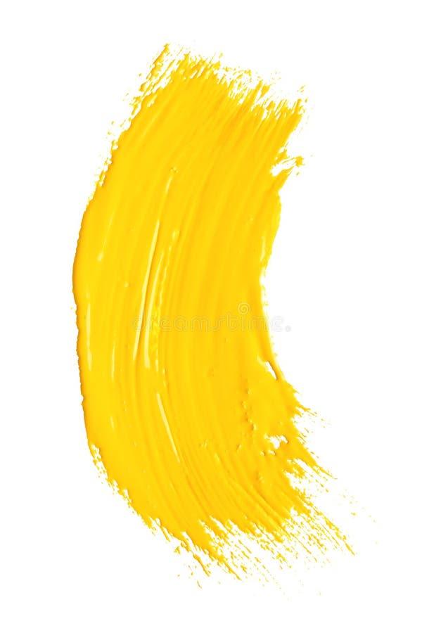 Абстрактный brushstroke желтой краски изолированный на белизне иллюстрация вектора