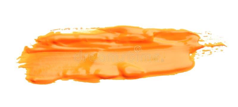 Абстрактный brushstroke оранжевой краски изолированный на белизне бесплатная иллюстрация