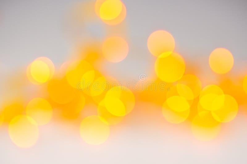 Абстрактным предпосылка запачканная апельсином светлая с кругами стоковое изображение rf
