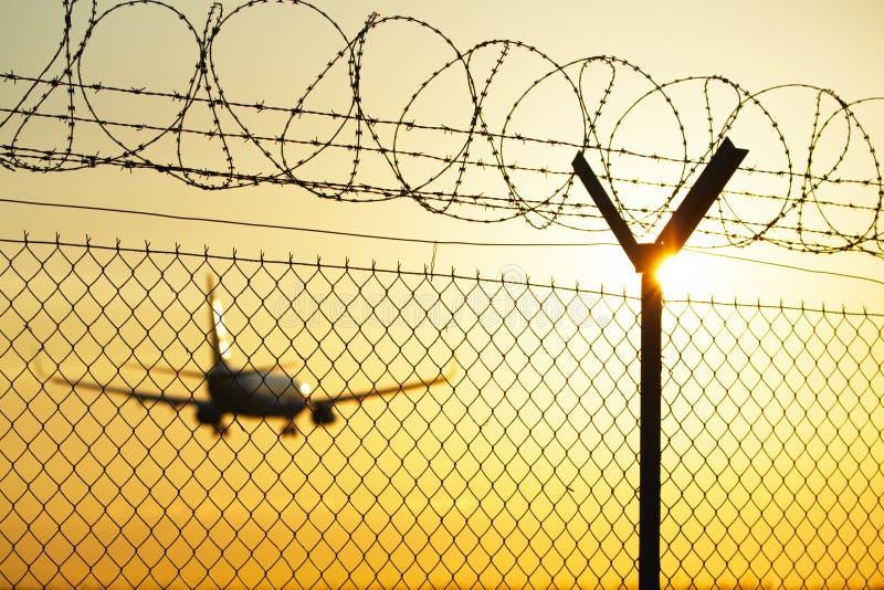 Авиапорт на заходе солнца стоковое фото rf