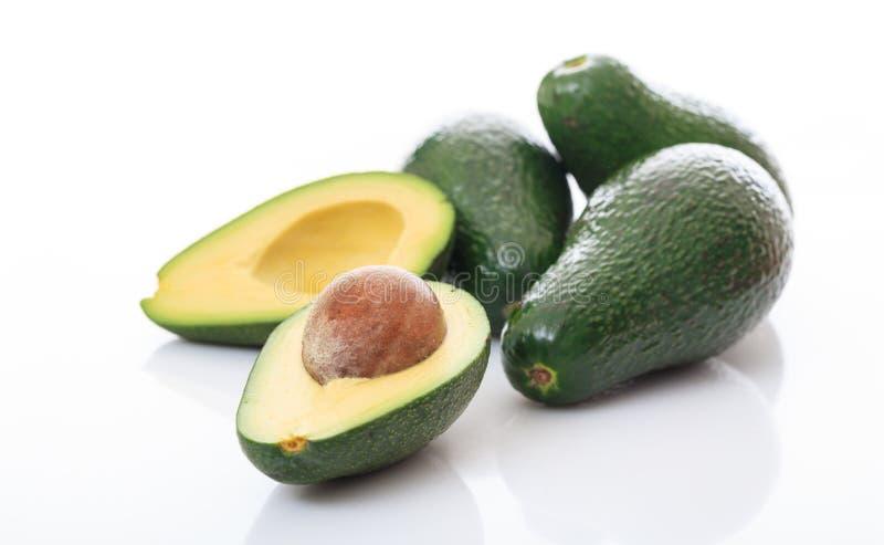 Авокадоы изолированные на белой предпосылке стоковые фотографии rf