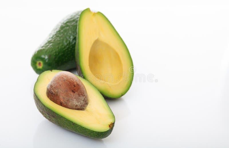 Авокадоы изолированные на белой предпосылке стоковая фотография rf