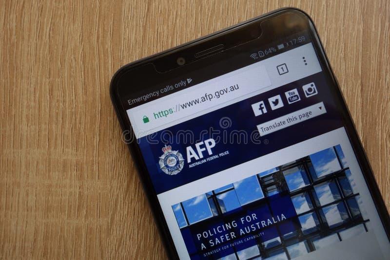 Австралийский федеральный вебсайт полиции AFP официальный показал на современном смартфоне стоковое фото