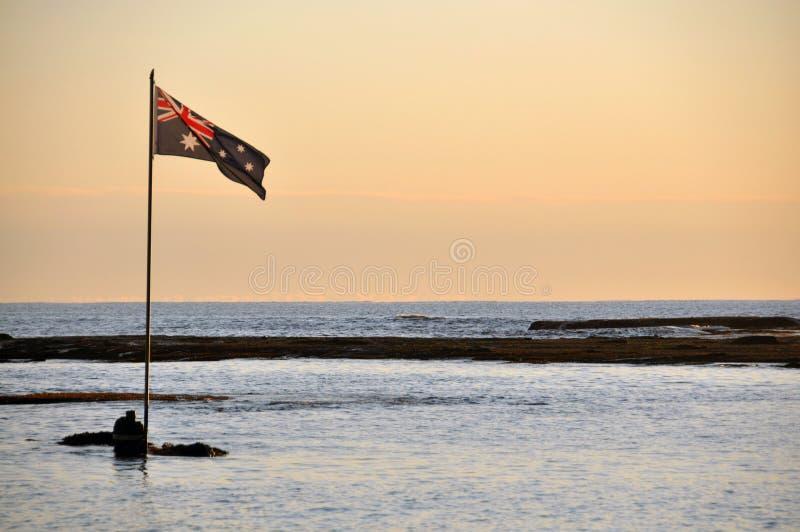 Австралийский флаг на рано утром стоковые изображения rf