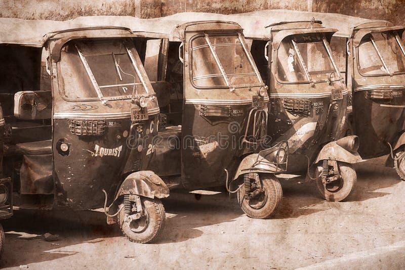 Автоматические такси рикши в Агре, Индии. Художественное произведение в ретро стиле. стоковая фотография rf