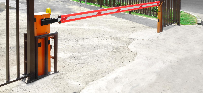 Автоматический поднимая барьер руки или заграждения стоковые изображения rf
