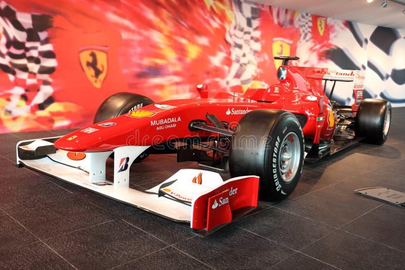 Автомобиль Формула-1 участвуя в гонке стоковые изображения rf