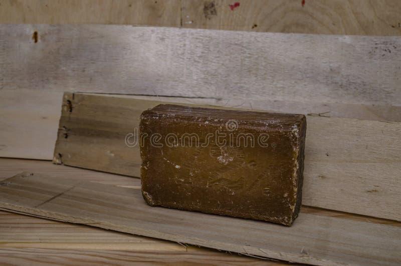 Адвокатура конца-вверх деревянных доск мыла домочадца коричневого стоковые изображения