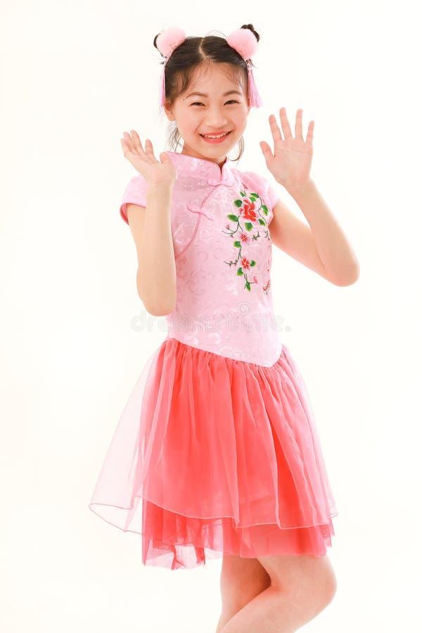 Азиатская девушка на белой предпосылке стоковые изображения