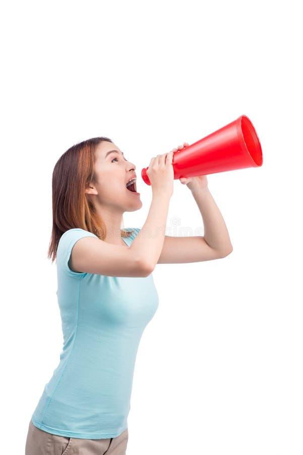 Азиатская девушка крича с мегафоном стоковое изображение