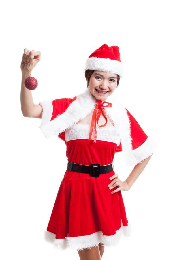 Download Азиатская девушка Санта Клауса рождества с шариком безделушки Стоковое Фото - изображение насчитывающей claus, повелительница: 81812292