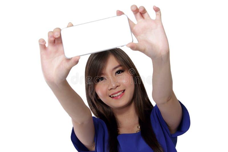 Азиатская девушка фотографирует стоковая фотография rf