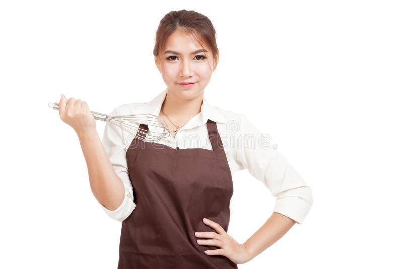 Азиатская девушка хлебопека с юркнет стоковая фотография rf