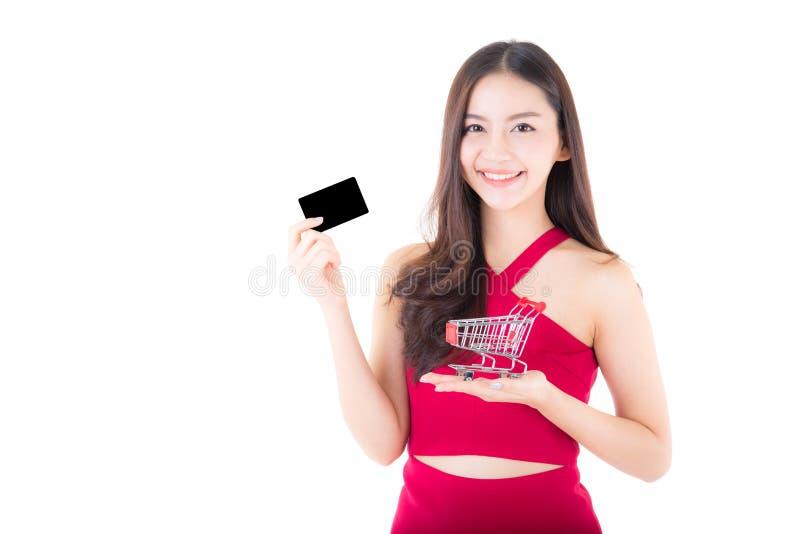 Азиатская женщина в концепции покупок изолированная на белой предпосылке стоковая фотография