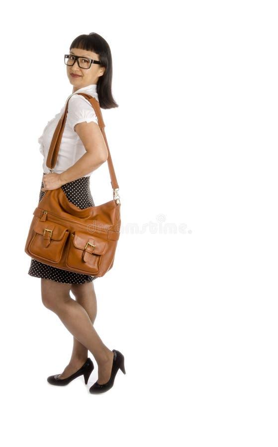 Азиатская женщина в рамке подбитого глаза стеклянной и офис оборудуют #1 стоковые фото