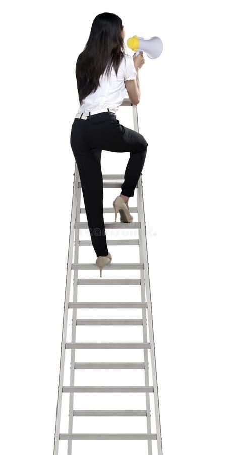Азиатская женщина держа мегафон на лестнице стоковые изображения rf
