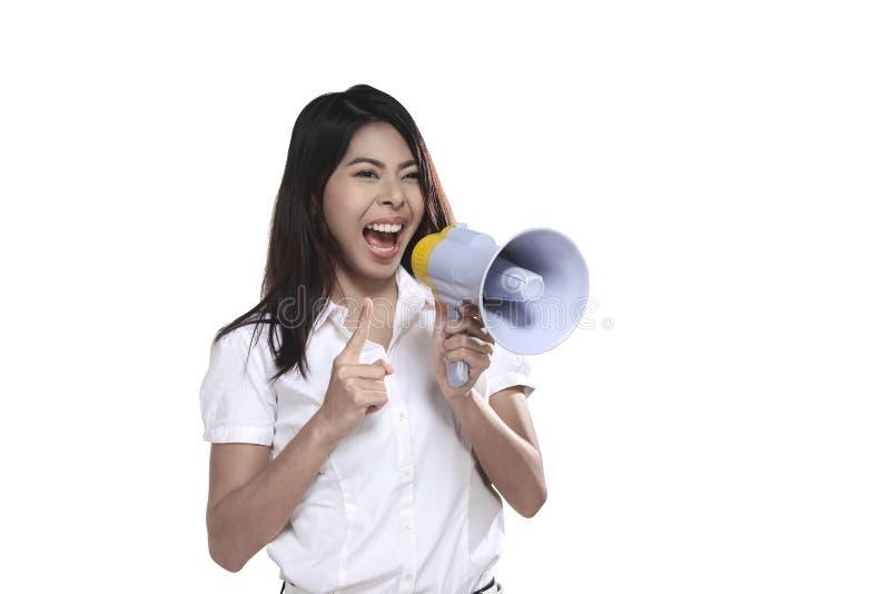 Азиатская женщина держа мегафон стоковое фото rf