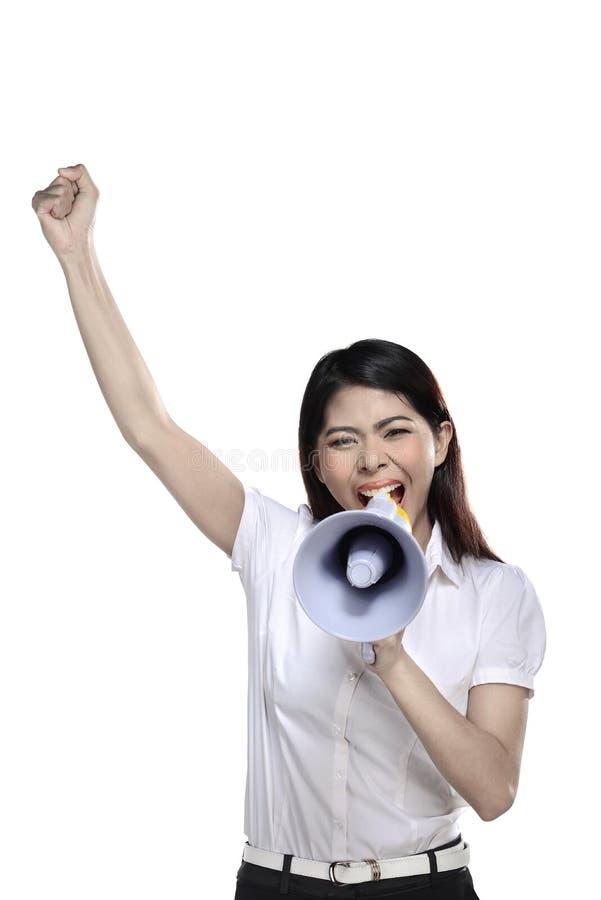 Азиатская женщина держа мегафон стоковое изображение