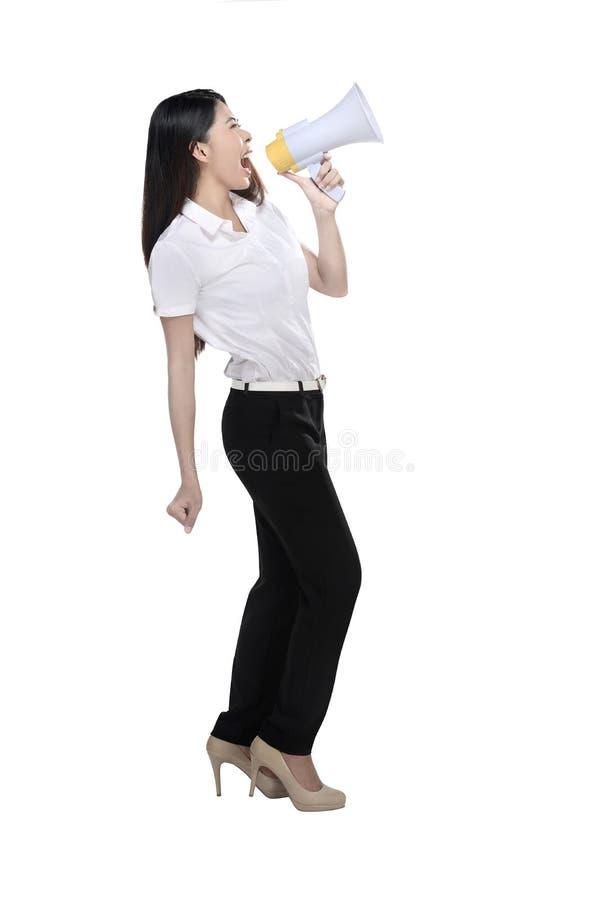 Азиатская женщина держа мегафон стоковые изображения rf