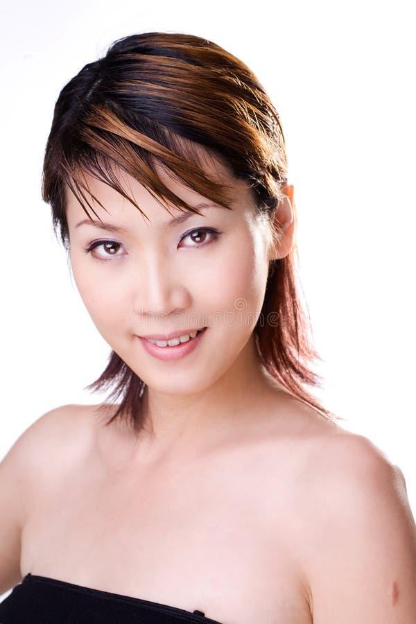азиатская женщина помадки усмешки стоковое изображение