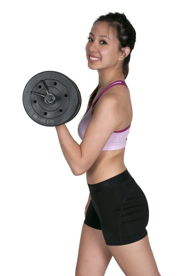 Азиатская женщина работая с весами стоковое изображение