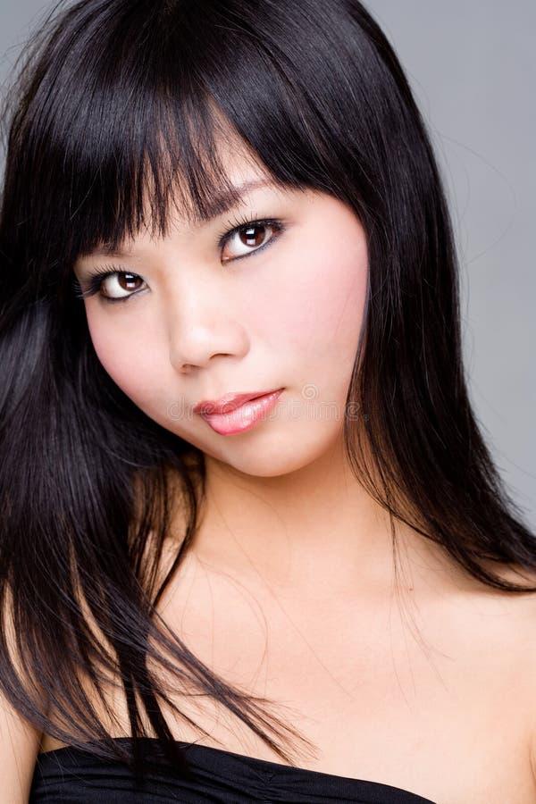 азиатская женщина черных волос стоковое фото rf