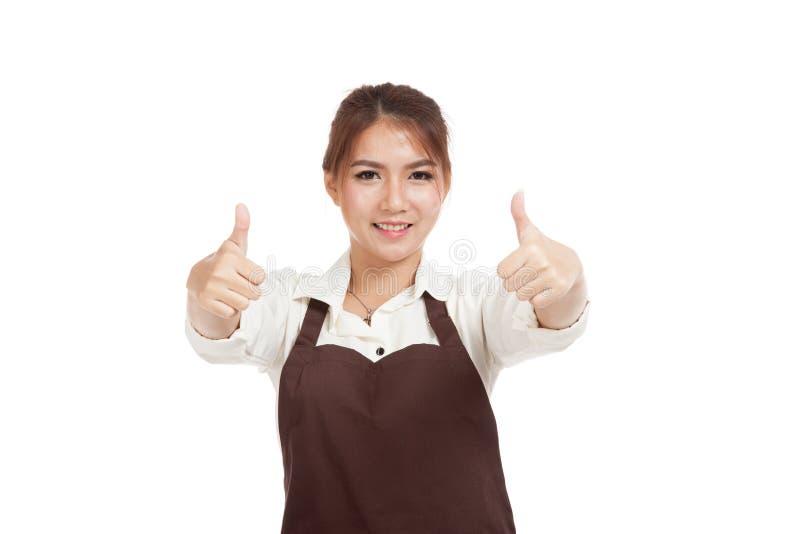 Азиатская официантка в выставке 2 рисбермы thumbs вверх стоковые фото