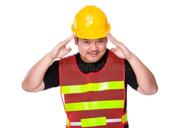 Азиатская рука инженера на голове для извиняется стоковые изображения