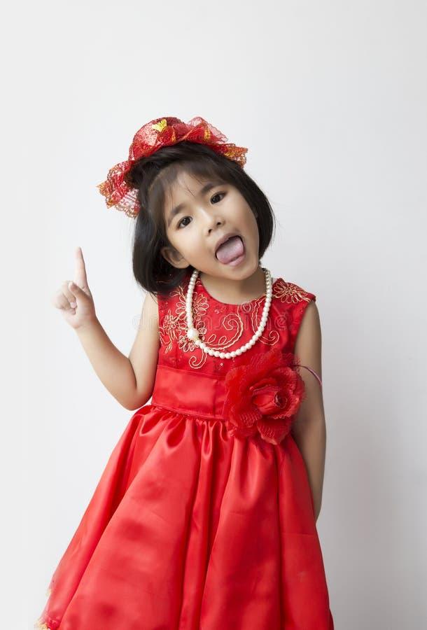 Азиатская улыбка девушки с костюмом стоковое фото