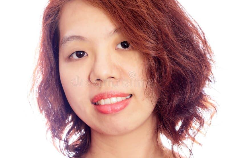 Азиатская улыбка жеста стороны женщины стоковая фотография rf