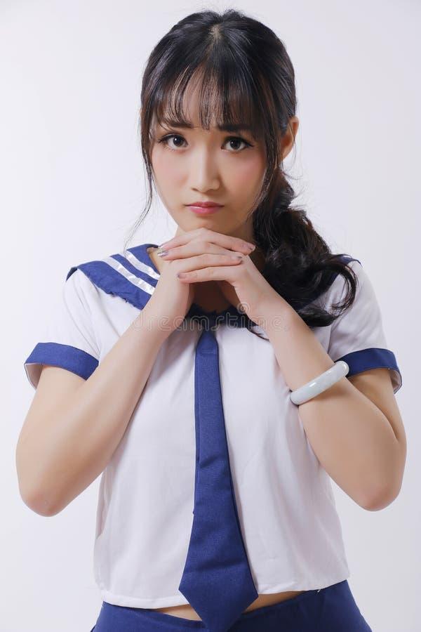 Азиатские девушка и костюм матроса стоковое изображение