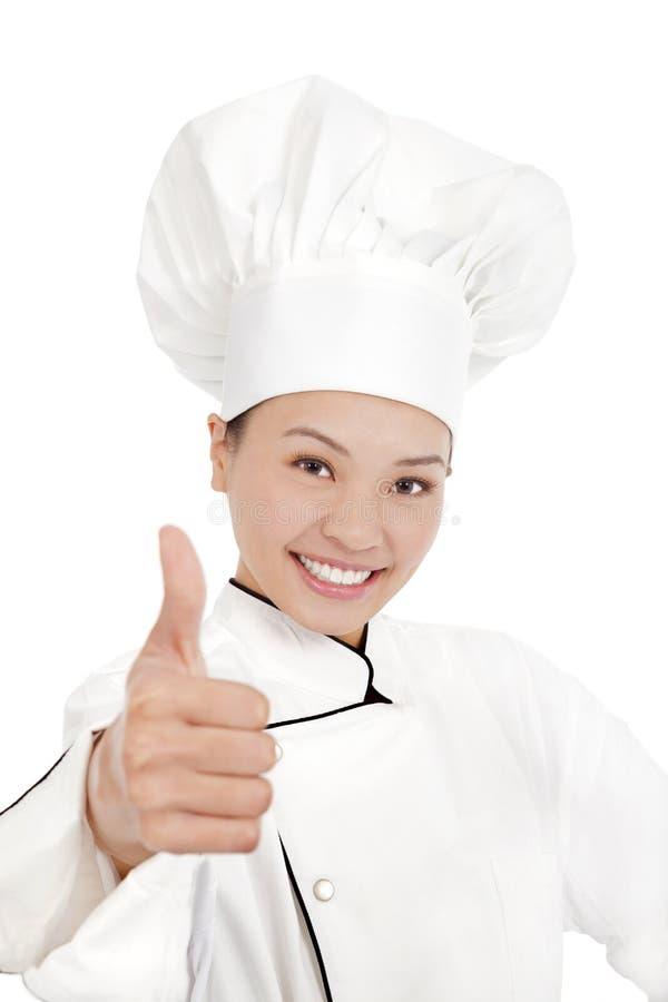 Азиатские женские шеф-повар, кашевар или хлебопек показывая большие пальцы руки вверх стоковые изображения rf