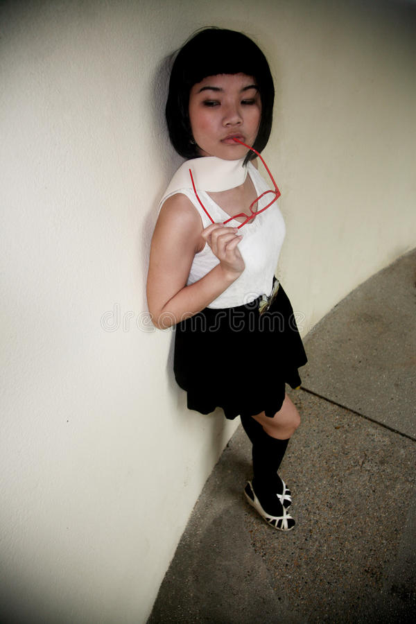 азиатские милые стекла девушки стоковые изображения rf